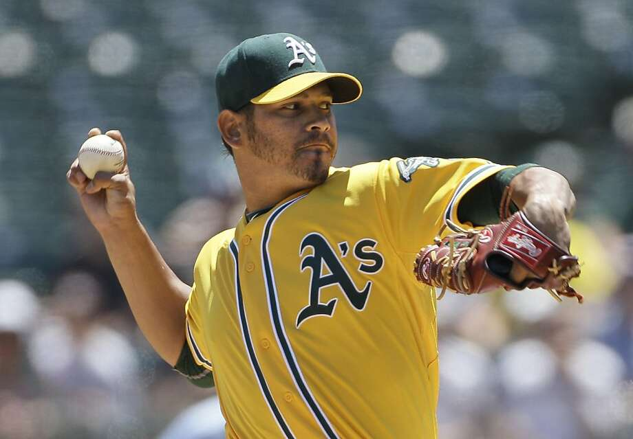 Oakland Athletics pitcher Guillermo Moscoso works against the Seattle Mariners during the first inning of a baseball game, Wednesday, July 6, 2011, in Oakland, Calif. Photo: Jeff Chiu, AP