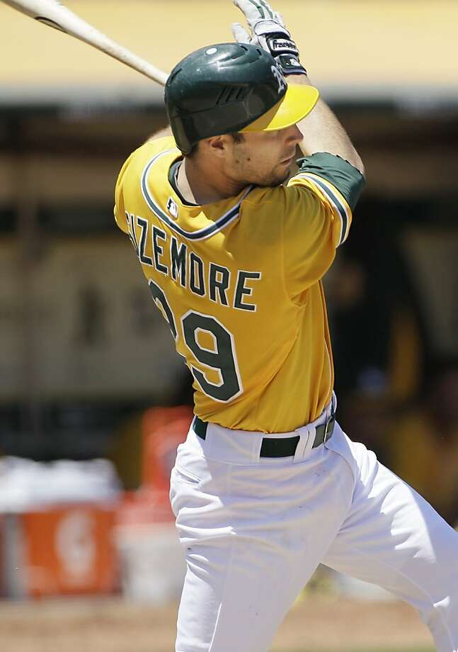 Oakland Athletics' Scott Sizemore (29) singles to score Cliff Pennington against the Seattle Mariners in the fifth inning of a baseball game in Oakland, Calif., Wednesday, July 6, 2011. The Athletics won 2-0. Photo: Jeff Chiu, AP