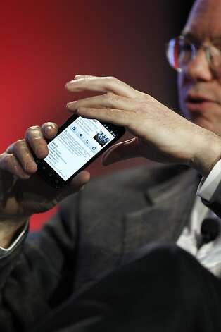 "Eric Schmidt, chief executive officer of Google Inc., holds up his phone running Google's Android OS as he speaks at the Web 2.0 Summit in San Francisco, California, U.S., on Monday, Nov. 15, 2010. This year's conference, which runs through Nov. 17, is titled ""Points of Control: The Battle for the Network Economy."" Photographer: Tony Avelar/Bloomberg *** Local Caption *** Eric Schmidt Photo: Tony Avelar, Bloomberg"