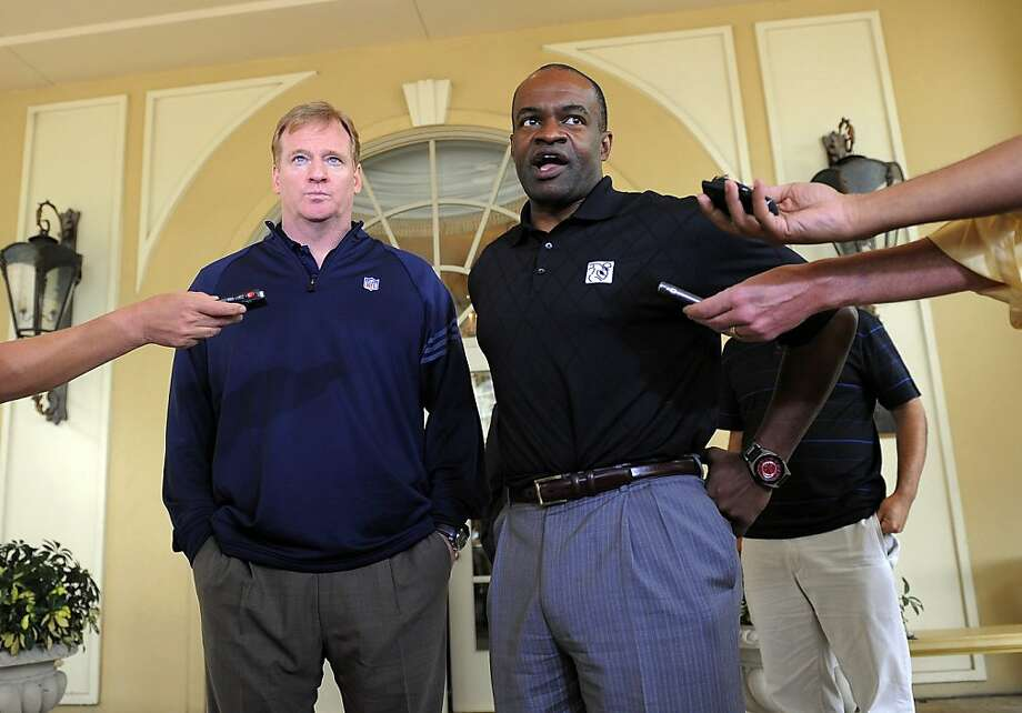 NFL commissioner Roger Goodell, left, and National Football League Players Association executive director DeMaurice Smith, right, speak to the media outside of the Ritz-Carlton hotel after addressing players during the NFLPA rookie symposium on Wednesday,June 29, 2011 in Sarasota, Fla. Photo: Brian Blanco, AP