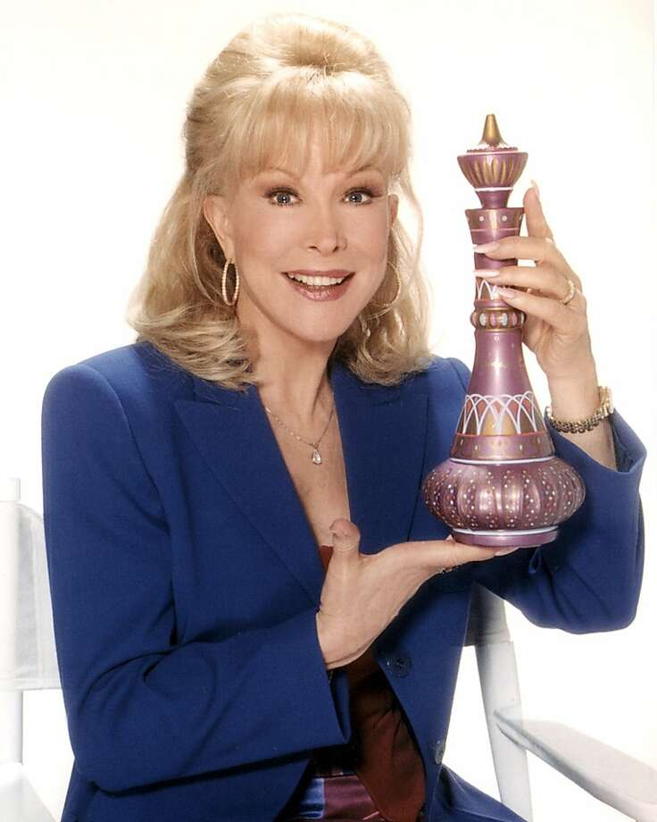 "Barbara Eden, a former Miss San Francisco, poses with her ""I Dream of Jeannie"" bottle. She'll appear at the Castro Theatre this weekend. Photo: Courtesy Marc Heustis"