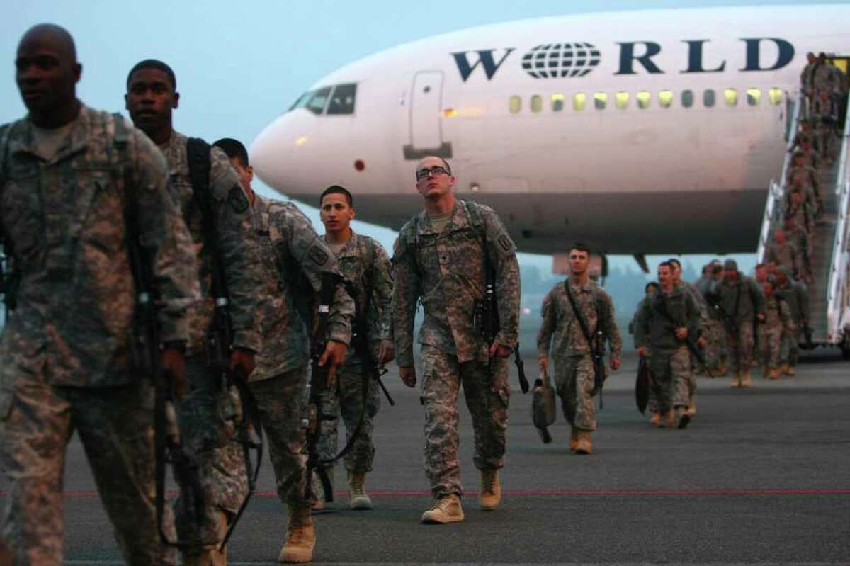 Troops from the 62nd Medical Brigade and the 17th Fires Brigade exit an aircraft after arriving at Joint Base Lewis McChord on Tuesday, December 6, 2011. The return of 170 Army troops from Iraq was the last large homecoming of troops from Iraq as U.S. military operations in that country are drawn down.