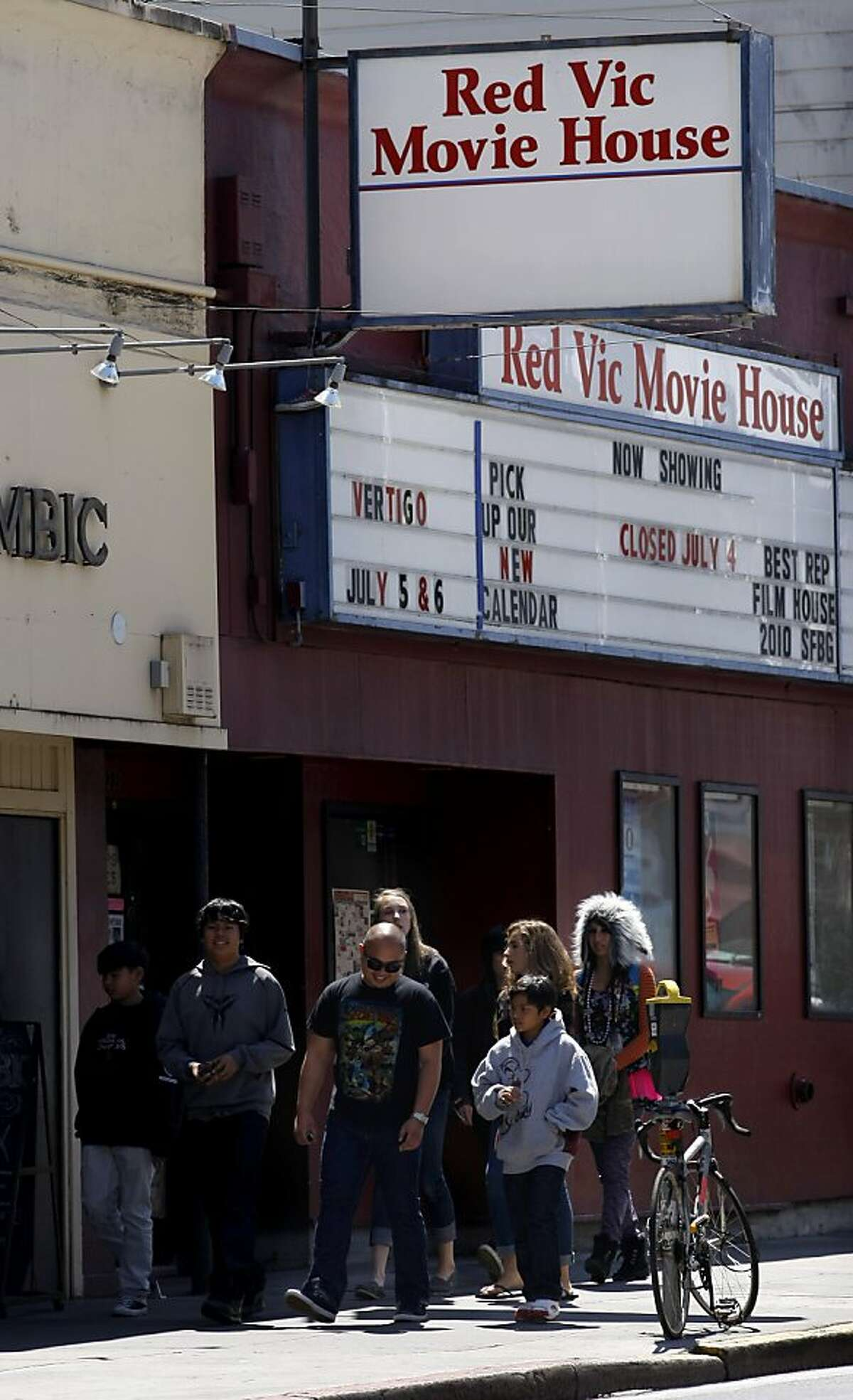 Crowds of tourists and residents walk past the old Red Vic Movie House, Wednesday July 6, 2011 at the Redvic Movie House in San Francisco, Calif. The theatre doors will close after 31 years on July 25.