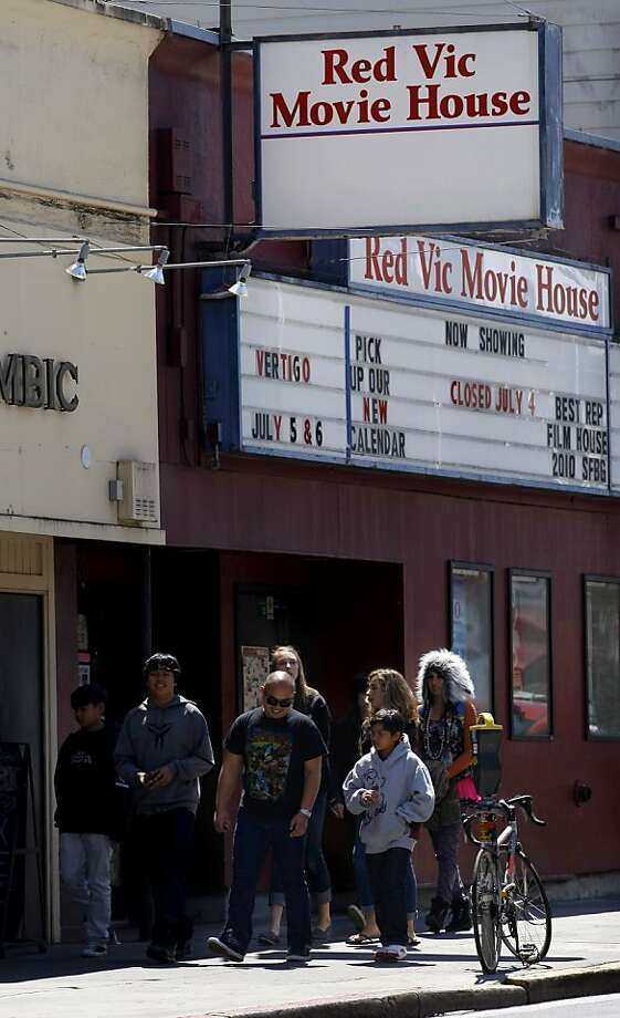 Crowds of tourists and residents walk past the old Red Vic Movie House, Wednesday July 6, 2011 at the Redvic Movie House in San Francisco, Calif.  The theatre doors will close after 31 years on July 25. Photo: Lacy Atkins, The Chronicle