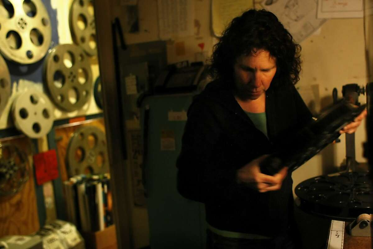 Claudia Lehan works in the projection room, Wednesday July 6, 2011 at the Red Vic Movie House in San Francisco, Calif. Lehan is one of four owners of the theatre, whose doors will close after 31 years on July 25.