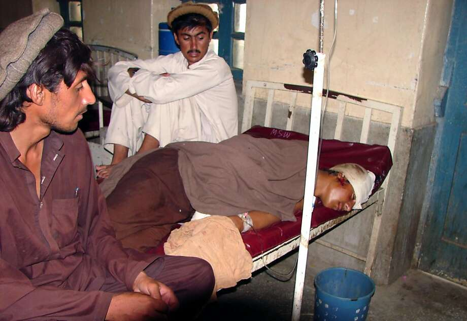 A young wounded Pakistani man rests in a hospital in the town of Miranshah on July 4, 2011.  Four Pakistanis including two children were wounded on Monday when a mortar shell fired from Afghanistan struck a village near the border, Pakistani security officials said.  The shell hit Bangedar village in the Ghulam Khan district of North Waziristan, the region where America has long called on Pakistan to launch an operation against Taliban and Al-Qaeda-linked militants. Photo: Thir Khan, AFP/Getty Images