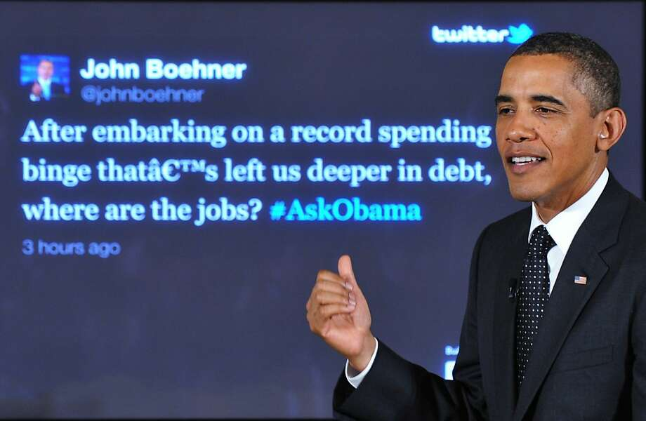 "US President Barack Obama responds to a question from House Speaker John Boehner during a ""Twitter Town Hall"" July 6, 2011 in the East Room of the White House in Washington, DC. Photo: Mandel Ngan, AFP/Getty Images"