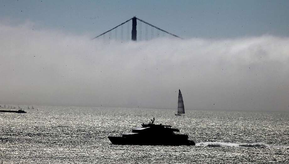 The Bay Areas natural air conditioning system, Fog rolls in covering the south tower of the Golden Gate Bridge Tuesday July 5, 2011. Photo: Lance Iversen, The Chronicle
