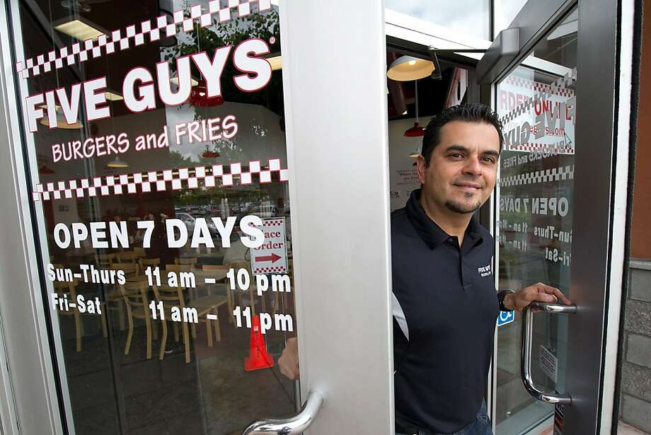 """Jose Garzona, chief operating officer of Tripart Inc. and the franchisee of a Five Guys Inc. restaurant, stands for a photograph in Dublin, California, U.S., on Wednesday, June 29, 2011. As twenty-somethings flock to Five Guys Burgers and Fries, eateriessuch as Applebee's, RubyTuesday Inc. and Chili's are trying to win them back with """"Girls' Night Out"""" parties, new menus and rehabbed stores. Photo: David Paul Morris, Bloomberg"""
