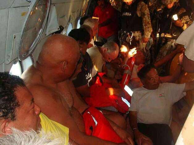 In this image released by the Mexican Navy on Monday July 4, 2011, survivors of a capsized boat sit inside a helicopter after being rescued by the Navy in the town of San Felipe, Mexico Monday July 4, 2011. A U.S. tourist died after a fishing boat capsized in an unexpected storm in the Gulf of California off the Baja California peninsula and of the 44 people on the boat, seven U.S. tourists remain missing along with one Mexican crew member, the Mexican Navy said. Photo: Semar, AP