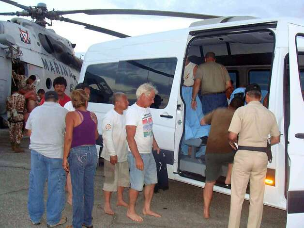 In this image released by the Mexican Navy on Monday July 4, 2011, survivors of a capsized boat are taken away in a vehicle after being rescued by the Navy  in the town of San Felipe, Mexico Monday July 4, 2011. A U.S. tourist died after a fishing boat capsized in an unexpected storm in the Gulf of California off the Baja California peninsula and of the 44 people on the boat, seven U.S. tourists remain missing along with one Mexican crew member, the Mexican Navy said. Photo: Semar, AP
