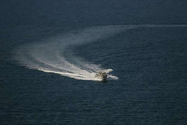 A Mexican Navy vessel searches the waters of the Gulf of California for survivors of a capsized fishing boat near San Felipe, Mexico, Monday, July 4, 2011. A U.S. tourist died after a fishing boat capsized in an unexpected storm in the Gulf of California off the Baja California peninsula and of the 44 people on the boat, seven U.S. tourists remain missing along with one Mexican crew member, the Mexican navy said. Photo: Francisco Vega, AP