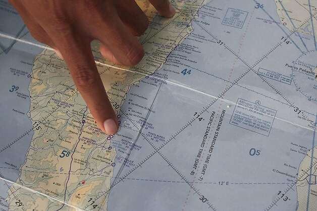 A Mexican Navy officer points the location in a map where survivors were rescued after a fishing boat capsized near San Felipe, Mexico, Monday, July 4, 2011. A U.S. tourist died after a fishing boat capsized in an unexpected storm in the Gulf of California off the Baja California peninsula and of the 44 people on the boat, seven U.S. tourists remain missing along with one Mexican crew member, the Mexican navy said. Photo: Francisco Vega, AP