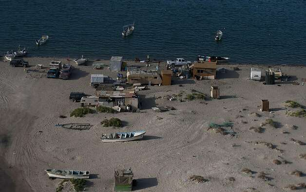 An aerial view of the fishing community of Punta Bufeo, whose residents rescued some tourists after a fishing boat capsized near the town of San Felipe, Mexico, Monday, July 4, 2011. A U.S. tourist died after a fishing boat capsized in an unexpected stormin the Gulf of California off the Baja California peninsula and of the 44 people on the boat, seven U.S. tourists remain missing along with one Mexican crew member, the Mexican navy said. Photo: Francisco Vega, AP