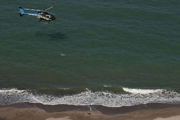 A state police helicopter searches the waters of the Gulf of California for survivors of a capsized fishing boat near San Felipe, Mexico, Monday, July 4, 2011. A U.S. tourist died after a fishing boat capsized in an unexpected storm in the Gulf of California off the Baja California peninsula and of the 44 people on the boat, seven U.S. tourists remain missing along with one Mexican crew member, the Mexican navy said. Photo: Francisco Vega, AP