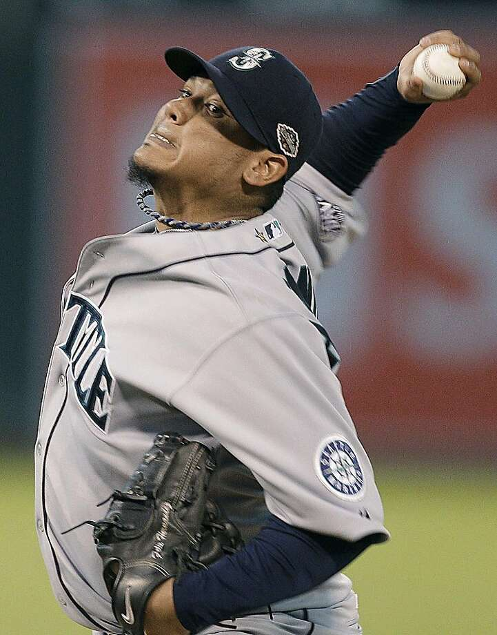Seattle Mariners pitcher Felix Hernandez works against the Oakland Athletics during the sixth inning of a baseball game Tuesday, July 5, 2011, in Oakland, Calif. Photo: Ben Margot, AP