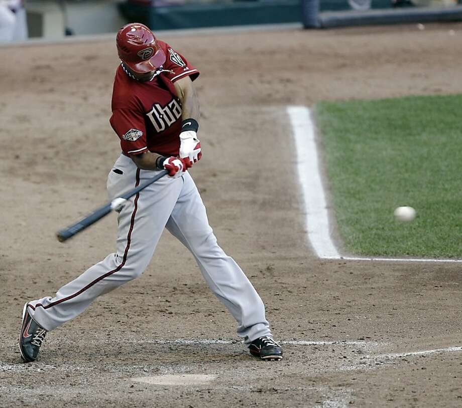 Arizona Diamondbacks' Chris Young swings on an RBI-single during the ninth inning of a baseball game against the Milwaukee Brewers on Monday, July 4, 2011, in Milwaukee. Photo: Morry Gash, AP