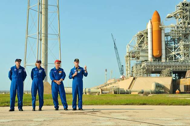CAPE CANAVERAL, FL - JUNE 22:  Space shuttle Atlantis Astronauts, Mission Specialists (L-R) Rex Walheim, Sandra Magnus, Pilot Doug Hurley, and Commander Chris Ferguson attend a press conference at the Launch Pad 39A with the Space shuttle in the background, during the Terminal Countdown Demonstration Tests and dress rehearsals for the July launch, at Kennedy Space Center June 22, 2011 in Cape Canaveral, Florida. The Atlantis mission STS-135 will be the last space shuttle to launch into orbit and will endthe NASA program. Photo: Roberto Gonzalez, Getty Images