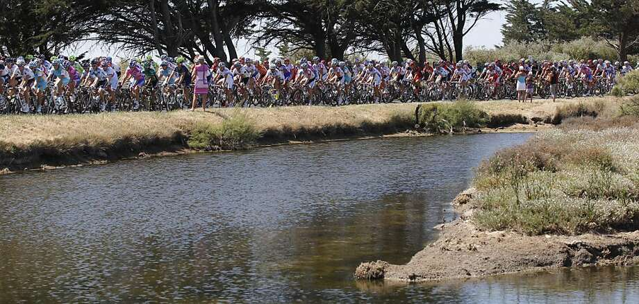 The pack passes a salt pan during the third stage of the Tour de France cycling race over 198 kilometers (123 miles) starting in Olonne sur Mer, Vendee region, and finishing in Redon, Brittany, western France, Monday July 4, 2011. Photo: Christophe Ena, AP