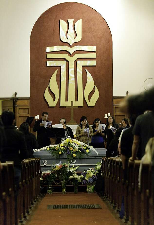 SAN FRANCISCO, CA--- Family members and friends sing during a memorial service for Freddy Roberto Canul-Arguello, at Mission Presbyterian Church. Freddy was killed on June 10 and his body was found in Buena Vista Park when firefighters responded to a small fire at the corner of Buena Vista East and Haight Street. After they put out the fire, they found Freddy's charred body. There have been no arrests made in the case. Photo: Tomas Ovalle, Special To The Chronicle