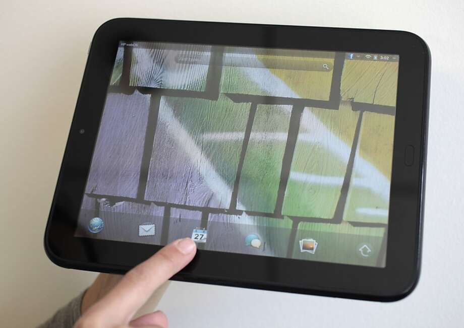 In this June 27, 2011 photo, the HP TouchPad is displayed in San Francisco. Photo: Eric Risberg, AP