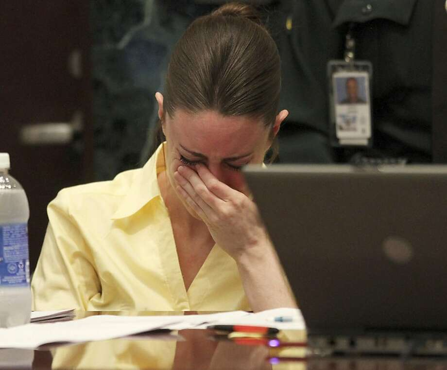 Casey Anthony reacts as the state presents its closing arguments in her murder trial in Orlando, Fla., Sunday, July 3, 2011. Anthony has plead not guilty to first-degree murder in the death of her daughter, Caylee, and could face the death penalty if convicted of that charge. Photo: Red Huber, AP