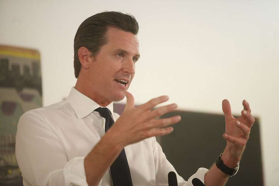 San Francisco Mayor Gavin Newsom talks about his newest budget plans during a press conference held at The Luggage Store Art Gallery on Market Street, Tuesday June 1, 2010 in San Francisco, Calif. Photo: Mike Kepka, The Chronicle