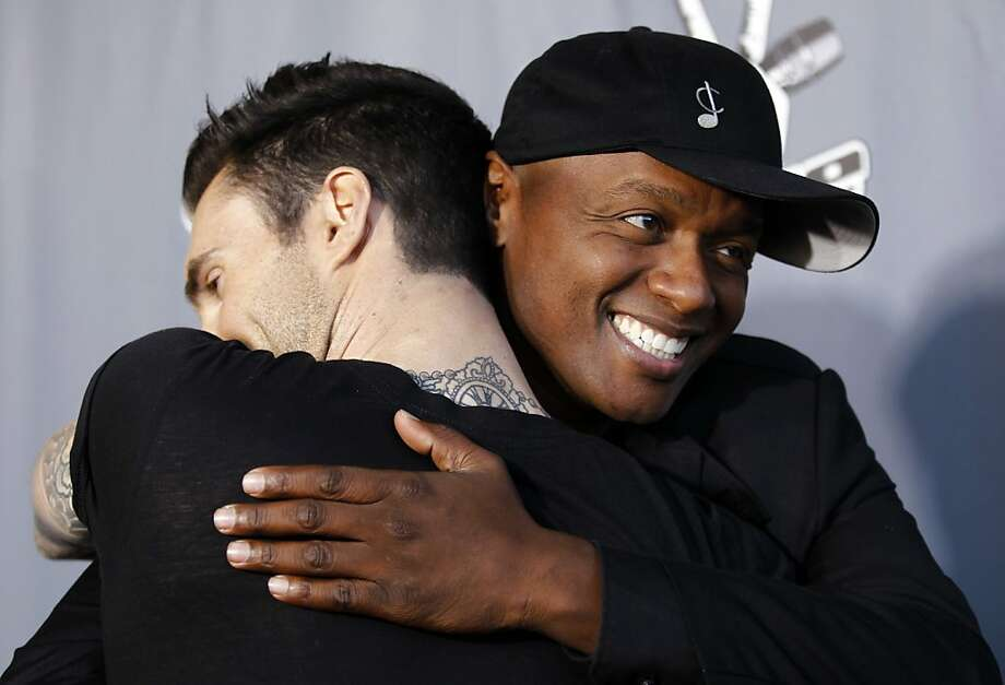 "Javier Colon, winner of ""The Voice"", right, hugs his coach Adam Levine after finale of ""The Voice"" in Burbank, Calif., Wednesday, June 29, 2011. Photo: Matt Sayles, AP"