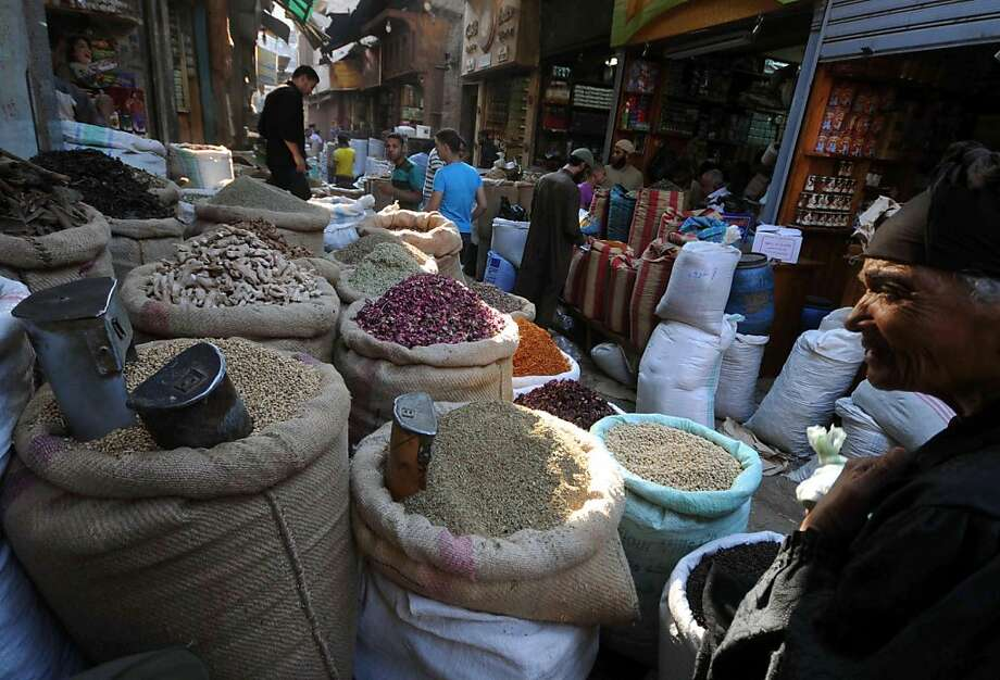 An Egyptian man walks past a shop selling pulses and grain at a market in Cairo on July 5, 2011. The European Union banned Egyptian fenugreek seeds linked to E.coli outbreaks in Germany and France and slapped a temporary ban on the import of all seeds andbeans from the country. Photo: Mohamed Hossam, AFP/Getty Images