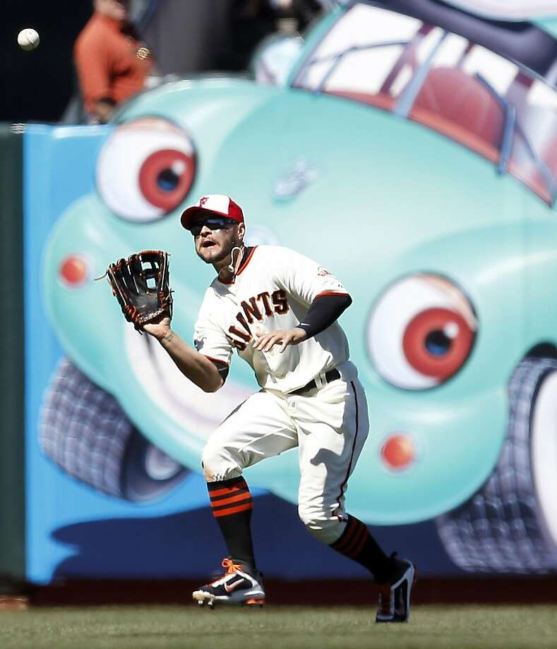 San Francisco Giants left fielder Cody Ross (13) makes the catch on a fly ball hit by San Diego Padres Kyle Phillips (16) during the sixth inning of a baseball game Monday July 4, 2011, in San Francisco. San Diego Padres won 5-3. Photo: Tony Avelar, AP