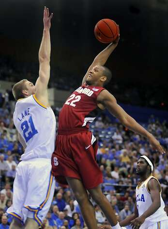 Stanford's Jarrett Mann, right, goes to the basket as UCLA's Brendan Lane defends in the first half of an NCAA college basketball game, Saturday, Jan. 22, 2011, in Los Angeles. Photo: Richard Hartog, AP