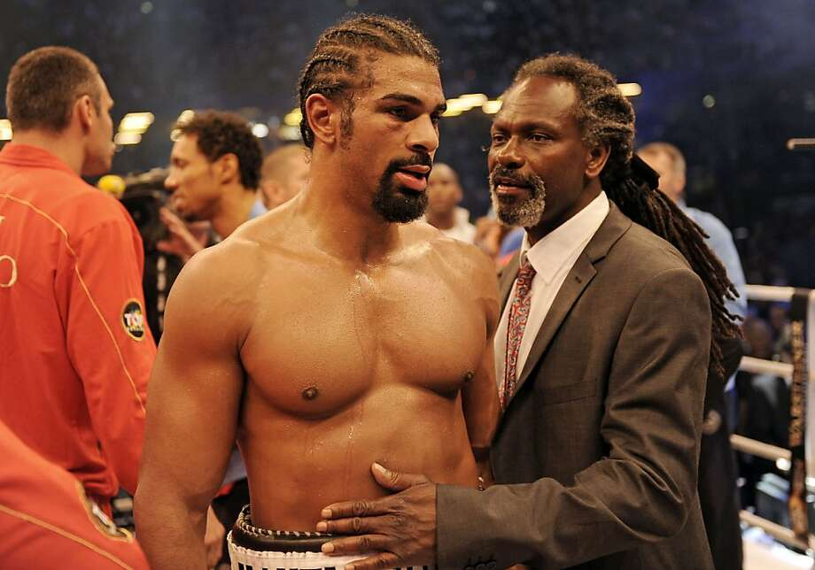 Heavyweight world boxing champion David Haye, left, of Britain reacts disappointed after losing his heavyweight unification title bout against Wladimir Klitschko of the Ukraine in Hamburg, Germany, Saturday, July 2, 2011. Haye lost his WBA title. Photo: Martin Meissner, AP