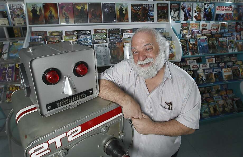Joe Ferrara, owner of the comic book store and museum Atlantis Fantasyworld, poses for a portrait with the Robot 2T2, from the Captain Cosmic TV show at his store on Wednesday, June 29, 2011, in Santa Cruz, Calif.  Joe Ferrara has been in the comics/fantasy business for more than 35 years, starting when he opened a Star Trek-themed shop in Berkeley in the mid-1970s. He's also an accomplished singer with a warm tenor, and is about to sing the National Anthem at a Giants game for the 30th straight year. Photo: Tony Avelar, Special To The Chronicle
