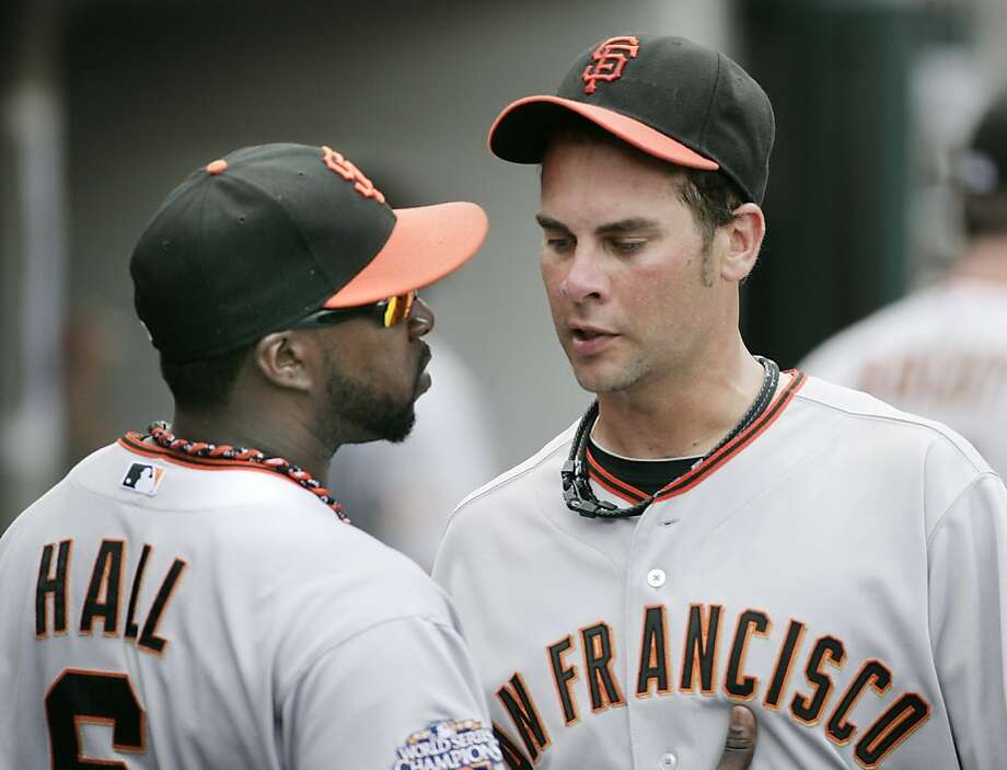 San Francisco Giants infielder Bill Hall, left, talks with starting pitcher Ryan Vogelsong after he was relieved in the seventh inning of an interleague baseball game against the Detroit Tigers, Sunday, July 3, 2011 in Detroit. Vogelsong gave up three runs and four hits in the Giants 6-3 loss to the Tigers. Photo: Duane Burleson, AP