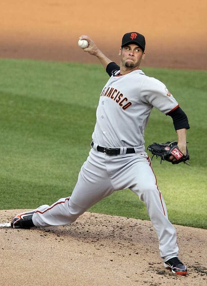 San Francisco Giants starting pitcher Ryan Vogelsong throws against the St. Louis Cardinals in the first inning of a baseball game, Tuesday, May 31, 2011 in St. Louis. Photo: Tom Gannam, AP
