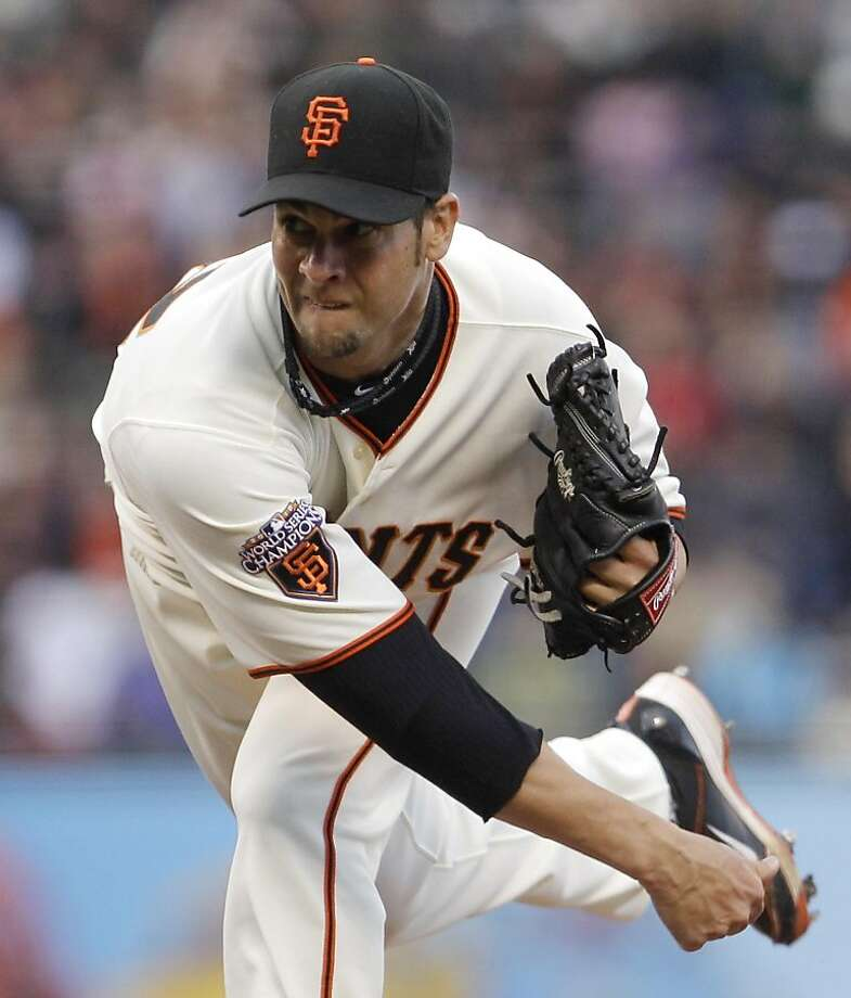 San Francisco Giants' Ryan Vogelsong follows through on a pitch to the Minnesota Twins during the first inning of a baseball game Wednesday, June 22, 2011, in San Francisco. Photo: Ben Margot, AP