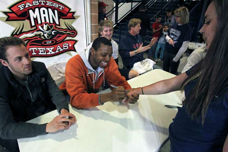 Dax Hill autographs an admirer's wrist at a benefit race organized by Josh Davis on Tuesday, Dec. 6, 2011 at the Davis Natatorium. Photo: TOM REEL, SAN ANTONIO EXPRESS-NEWS  / © 2011 San Antonio Express-News