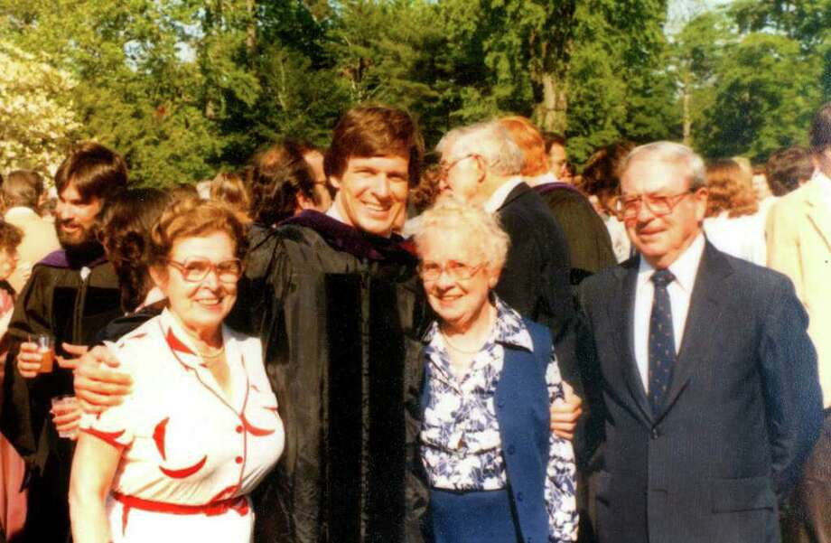 Gov. Dan Malloy graduated Magna Cum Laude from Boston College and also earned his law degree from Boston College Law School. A family photo taken at Gov. Dan Malloy's 1980 graduation from Boston College Law School shows the governor with his mother, Agnes, his aunt Esther Peterson and his father Bill Malloy, Sr. Photo: Contributed Photo