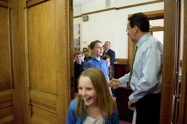 Governor Dannel P. Malloy greets a group of schoolchildren as they visit his office at the State Capitol  in Hartford, Conn. on Thursday April 15, 2011. The day marked the Governor's 100th day in office. Photo: Kathleen O'Rourke / Stamford Advocate
