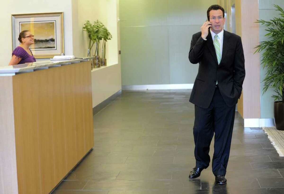 Gov. Dan Malloy conduct business on his cellphone while Stamford, Conn. on Wednesday May 11, 2011.