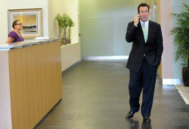 Gov. Dan Malloy conduct business on his cellphone while Stamford, Conn. on Wednesday May 11, 2011. Photo: Kathleen O'Rourke / Stamford Advocate