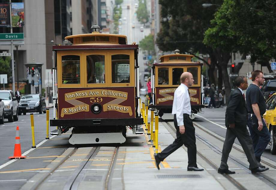 California St. cable cars are seen in San Francisco on June 27, 2011. The city held a ribbon cutting ceremony to welcome back the line after being closed due to repairs since December. Photo: Susana Bates, Special To The Chronicle