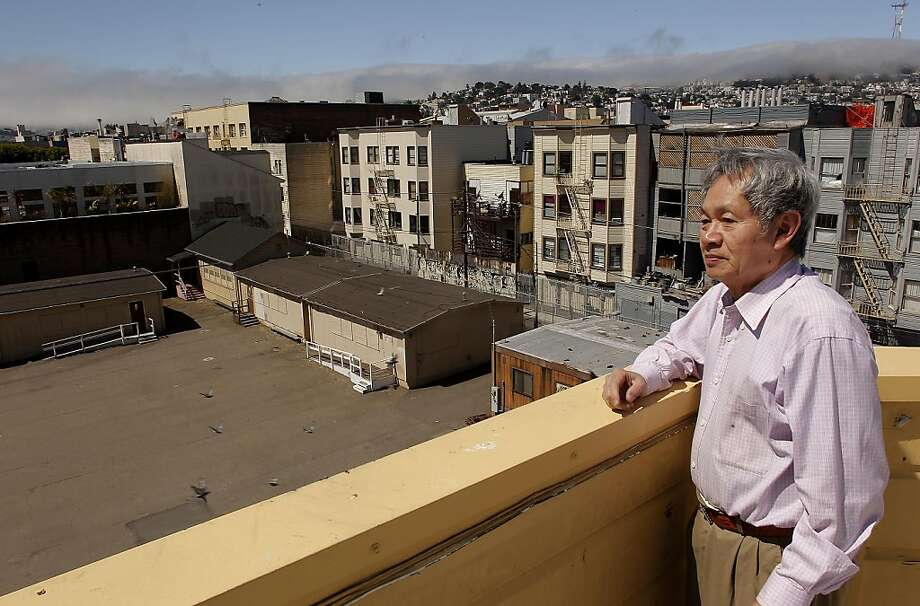 Immigration Consultant, Edward Ma, who has an office in the building next door, looks out over the San Francisco School District property at 1950 Mission Street on Wednesday June 22, 2011 in San Francisco, Ca. The School District  is trying to figure what to do with the property and portable buildings. Photo: Michael Macor, The Chronicle