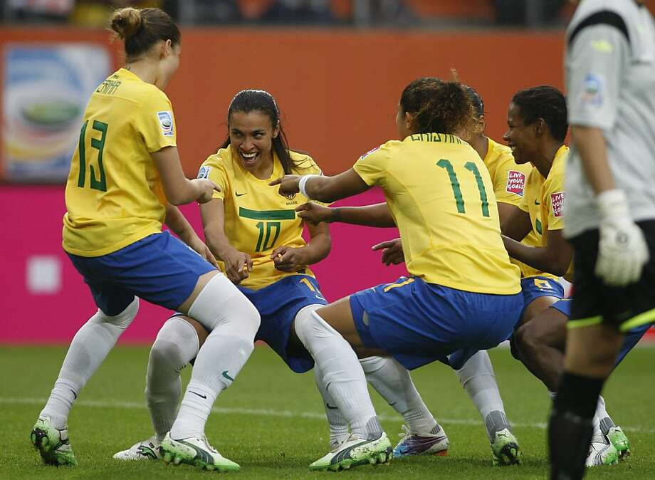 Brazil's Marta, 2nd left, dances with teammates as she celebrates scoring her side's 3rd goal during the group D match between Brazil and Norway at the WomenÍs Soccer World Cup in Wolfsburg, Germany, Sunday, July 3, 2011. Photo: Petr David Josek, AP