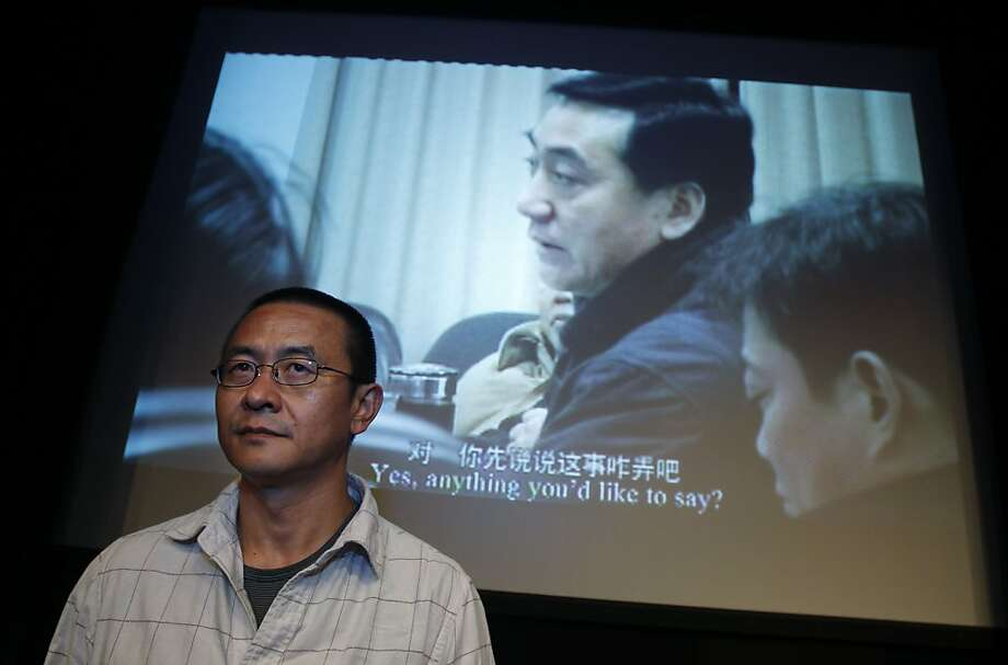 """Chinese director Zhou Hao stands in front of a screen showing his documentary feature """"The Transition Period"""" during a presentation ceremony of the Chinese Documentary Festival in Hong Kong Saturday, July 2, 2011. News of the arrests of prominent Chinesedissidents like Ai Weiwei and Liu Xiaobo has dominated headlines and painted a picture of harsh oppression and censorship. But Zhou and another independent Chinese documentary maker attending the Hong Kong festival say they enjoy a great deal of creativefreedom and can tackle most subjects they are interested in, in part thanks to the dissidents' sacrifices. Photo: Kin Cheung, AP"""