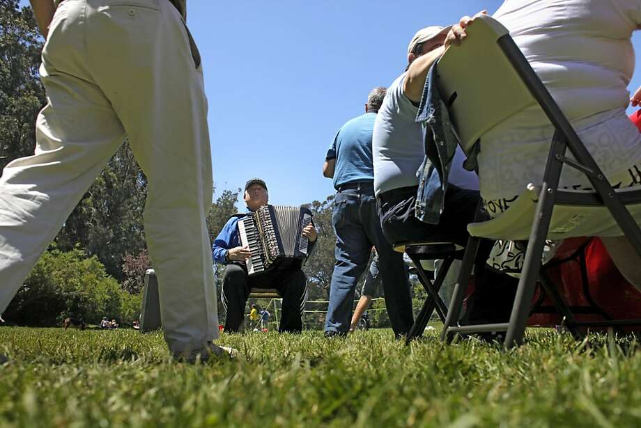 Accordion player Simon Shtauber plays for the German cab drivers' celebration Sunday in Golden Gate Park in San Francisco. Photo: Lacy Atkins, The Chronicle