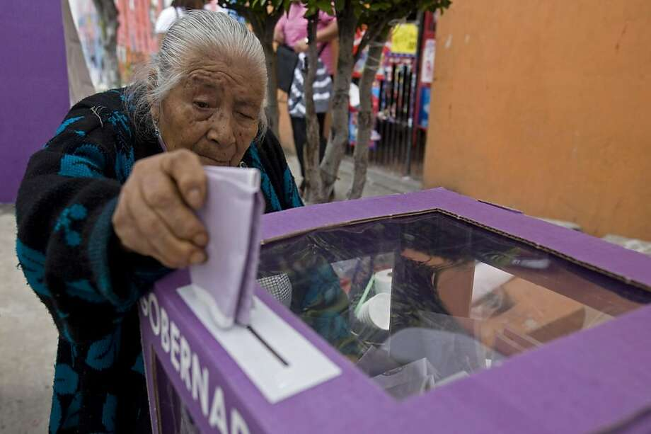 Concepcion Ricardo Cruz, 91, casts her vote at a polling station in Nezahualcoyotl, Mexico, Sunday July 3, 2011. There's more at stake than picking a governor as voters go to the polls Sunday in the state of Mexico, with 15 million people the country's most populous state and a bellwether for next year's presidential election. Photo: Moises Castillo, AP
