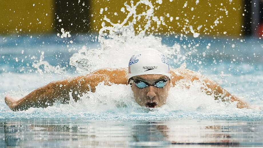U.S. swimmer Michael Phelps competes during the 100-meter butterfly event at the Canada Cup swim meet in Montreal, Sunday, July 3, 2011. Photo: Graham Hughes, AP