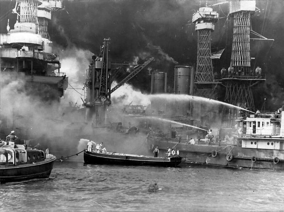 Official U.S. Navy photo of firefighters battling the fire on the U.S.S. West Virginia that was started by Japanese torpedoes and bombs in Pearl Harbor, Hawaii, on December 7, 1941. Photo: U.S. Navy