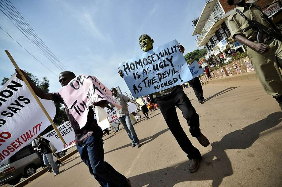 Demonstrators carried anti-gay banners during a December 2009 rally in Uganda's capital, Kampala. Human rights advocates in Uganda say a conference by the three American evangelical Christians helped set the stage for a bill to impose a death sentence on homosexuality. (Marc Hofer/The New York Times)  Ran on: 01-04-2010 Demonstrators carry anti-gay banners during a rally in Uganda's capital, Kampala, last month. Photo: Marc Hofer, NYT